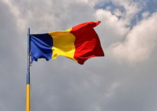 Romania flag. Waving on a cloudy sky Stock Photo