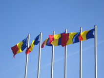 Romanian flags waving on flagpoles Royalty Free Stock Image