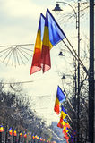 Romanian Flags in the wind, National Day of Romania, Kisselleff Stock Photography