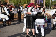 Romanian folk dancers dancing in traditional costumes Royalty Free Stock Image