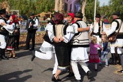 Romanian folk dancers dancing in traditional costumes Stock Photography