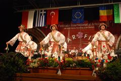 Romanian folk dancers at an international festival Royalty Free Stock Photo