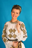 Romanian folklore clothes traditional on blue azzure background. Lovely stock photos