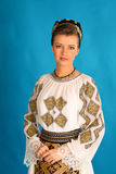 Romanian folklore clothes traditional on blue azzure background. Lovely royalty free stock photo