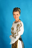 Romanian folklore clothes traditional on blue azzure background Royalty Free Stock Photo
