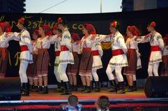 Romanian folklore group performance. Romanian teen folklore dance group performing at stage of the International Children`s Folk Festival  in Varna city Seaside Stock Photos
