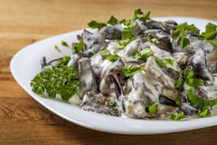 Romanian food - mushrooms with sour cream and parsley Stock Photo
