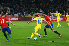 Romanian football player Nicolae Stanciu in action against Spain Stock Photos