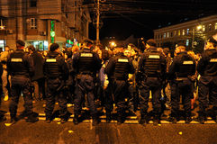 Romanian Gendarmerie and Police abusive violence against peaceful protesters Stock Photos