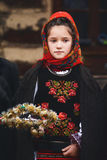 Romanian girl in folklore costume. Romanian girl in folklore traditional romanian costume   singing Christmas carols at a local fair Royalty Free Stock Photo