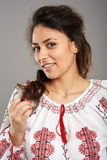 Romanian girl in traditional costume Stock Photos