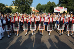 Romanian group of dancers in traditional costumes Stock Photo