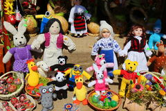 Romanian handmade dolls. And baskets with painted eggs Stock Images