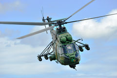 Romanian helicopter IAR 330 `Puma` in military polygon Stock Images