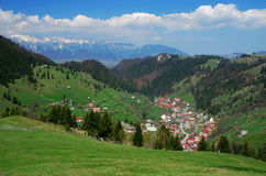 Romanian highland village. Landscape view of the hillside and village of Moeciu, Romania Stock Image