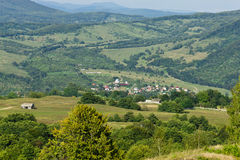 Romanian hillside and village. Landscape view of the village of Corbeni, Romania Royalty Free Stock Photos
