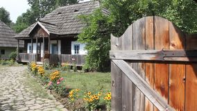Romanian household - wooden houses stock footage