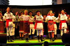 Romanian kids folklore group dancing Stock Image