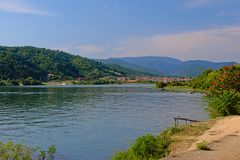 Romanian landscape with river Danube with old wooden pier and mountains in the background. Landscape with river Danube with old wooden pier and mountains in the stock images