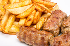 Romanian Meatballs Or Mici And Fried Chips Royalty Free Stock Photography