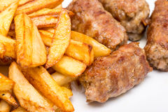 Romanian Meatballs Or Mici And Fried Chips Stock Photos