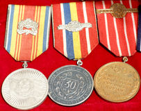 Romanian medals. Some Romanian communist medals exposed on red background Royalty Free Stock Photography