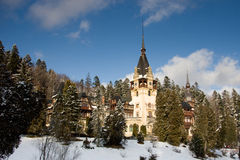 Romanian Medieval Castle. Old Romanian Peles castle near the mountain town of Sinaia. Winter landscape Royalty Free Stock Photo