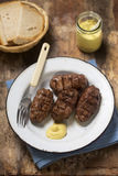 Romanian mici. With mustard and bread Royalty Free Stock Photo