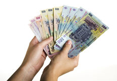 Romanian money with clipping path. Woman hands holding a bunch of Romanian money Royalty Free Stock Photos
