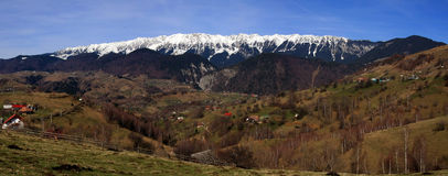 Romanian mountain village panorama. Magura and Pestera villages are set at the base of Piatra Craiului Mountains in Romania. In Romanian Piatra Craiului means Royalty Free Stock Photo