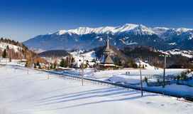 Romanian mountains and wooden church Stock Photo