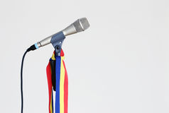 Romanian music. Silver microphone on a stand with the romanian flag attached Royalty Free Stock Photos