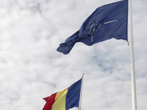 Romanian and Nato flags Stock Image