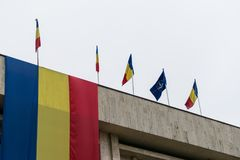 Romanian and NATO flags in the wind.  stock images