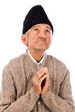 Romanian old peasant praying Stock Images