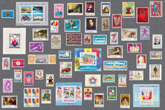 Romanian old stamps collection. On grey background Stock Photo