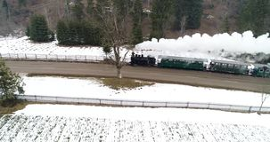 Romanian old steam train in Bucovina aerial view with drone stock footage