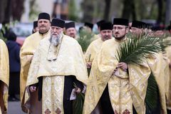 Romanian Orthodox priests during a Palm Sunday pilgrimage procession in Bucharest. Bucharest, Romania - April 20, 2019: Romanian Orthodox priests during a Palm royalty free stock photo