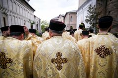Romanian Orthodox priests during a Palm Sunday pilgrimage procession in Bucharest. Bucharest, Romania - April 20, 2019: Romanian Orthodox priests during a Palm stock images