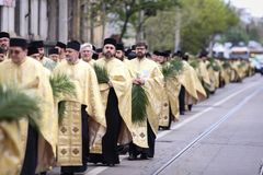 Romanian Orthodox priests during a Palm Sunday pilgrimage procession in Bucharest. Bucharest, Romania - April 20, 2019: Romanian Orthodox priests during a Palm royalty free stock image