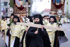 Romanian Orthodox priests during a Palm Sunday pilgrimage procession in Bucharest. Bucharest, Romania - April 20, 2019: Romanian Orthodox priests during a Palm stock photography