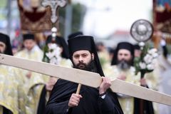 Romanian Orthodox priests during a Palm Sunday pilgrimage procession in Bucharest. Bucharest, Romania - April 20, 2019: Romanian Orthodox priests during a Palm stock image