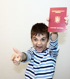 Romanian passport. Child shows the new Romanian passport Royalty Free Stock Photography