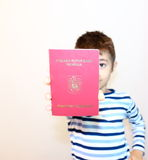 Romanian Passport. Child shows the new Romanian passport Royalty Free Stock Photos