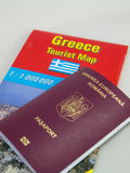Romanian passport on Greece tourist map Royalty Free Stock Photos