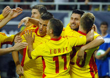 Romanian players celebrate goal in Romania-Hungary Stock Images