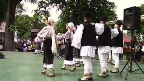 Romanian popular dance. Group of men and women dancing Romanian popular dance stock video footage