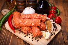 Romanian pork and lamb sausages, mititei with spices Stock Images
