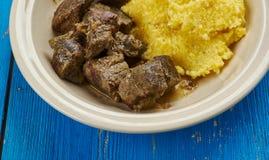 Romanian pork liver stew. Tocana Pomana porcului - Romanian pork liver stew with corn porridge Stock Images