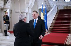 KLAUS IOHANNIS AND JEAN-CLAUDE JUNCKER MEETING AT COTROCENI PALACE. Romanian President Klaus Iohannis, right and Jean-Claude Juncker the President of the royalty free stock photo